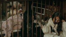Девушка топлес в клетке